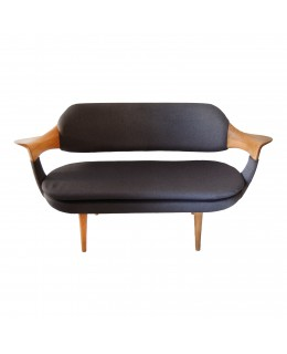 Design sofa in oak and fabric.